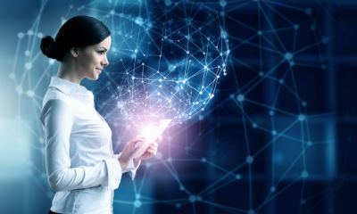 Woman with Tablet in Futuristic Background